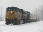 CSX 5448 & 7833 rolls into the yard along the snow covered even lead with Q335-26