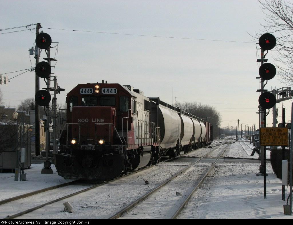 SOO 4449 bringing its' train through the B-17 interlocking before backing into the yard