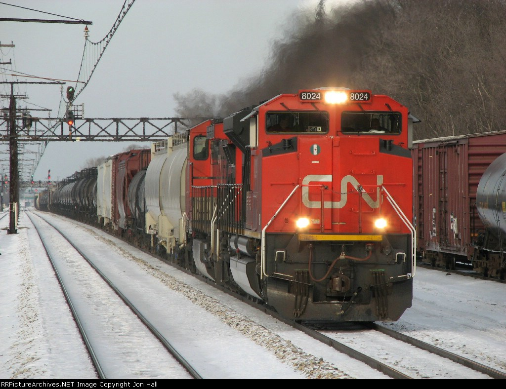 CN 8024 & 2610 work hard as they start south with M336 next to the Metra Electric tracks