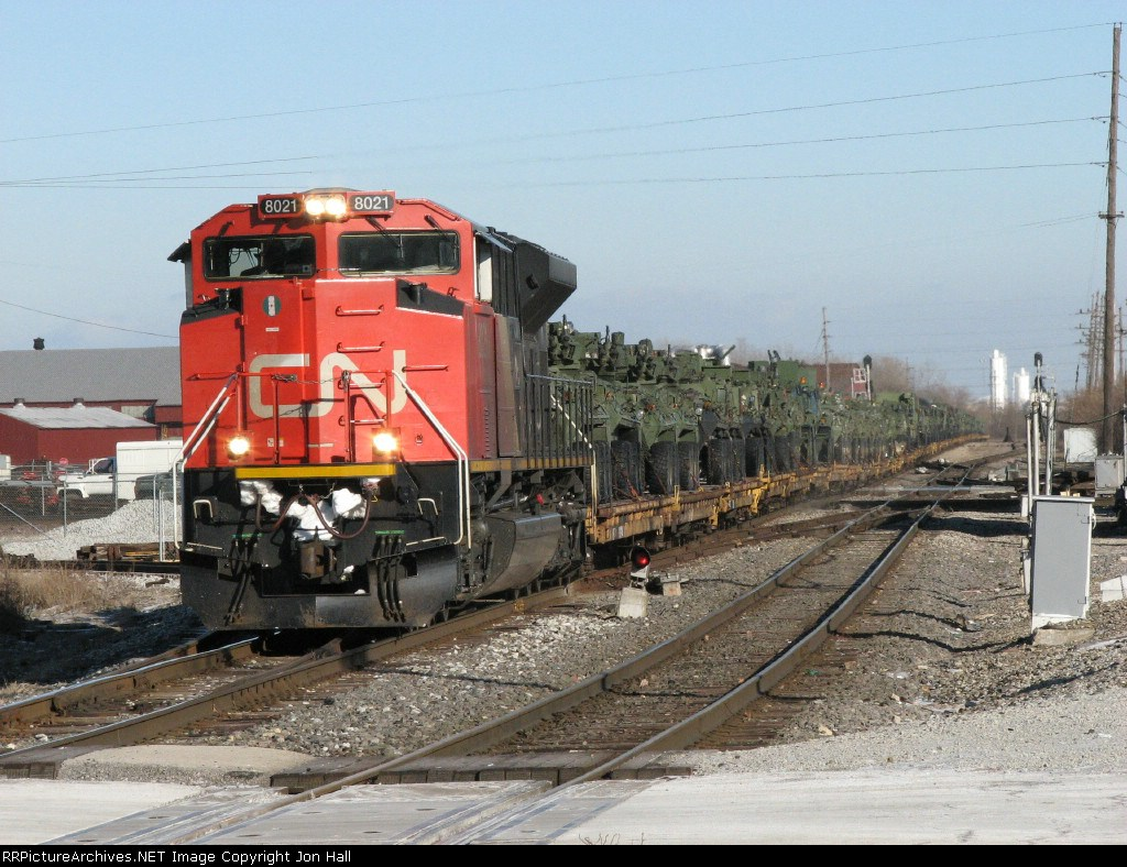 8021 rolls westward on the J with X373 as it crosses the Villa Grove Sub