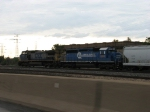 CSX 8809 & 7910 wait to continue west with Q387-12