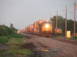 Q161 pulls up as CSX 9026 sits in Curtis yard with a coke train