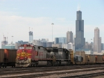 BNSF 761 waits for a crew as the skyline of The Loop looms