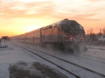 METX 420 heads away at sunrise in a cloud of snow