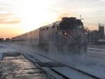 METX 112 pushing its' train towards the sunrise