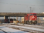 240 pulls out of the yard as SOO 4511 sits under the Mannheim Road overpass
