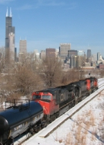 M338 heads away as the city skyline looms