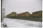 UP 5090 passes UP 7732 in the snow at Nampa going west.