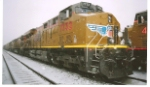 UP 7732 waits to go west in the snow storm.