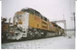 UP 8593 with UP 5090 as leader with a cow catcher full of snow passes me in a snow storm.