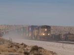 UP 5511 leads an EB doublestack through Border Patrol dust at 12:49pm