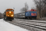 BNSF 8821 headed back to the PRB with an empty coal train parade, passes inbound Metra Dinky.