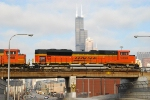 BNSF 9390 w/loaded DEEX hopper on the St Charles Air Line passing the Sears Tower.