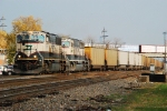 BNSF 9795 headed west with DEEX empties for PRB.