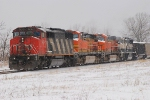 CN 5424 with three BNSF units on the New Years day with a loaded FSTX train headed east.