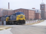 CSX 333 leads an empty coal train past the mill
