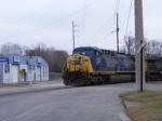 CSX 300 rounds the curve acroos Fenwick Street