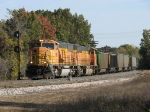 BNSF 9856 leads E949 past the west end of Holland siding