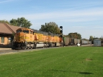 E949-16 starts westward on the Grand Rapids Sub as it passes the depot