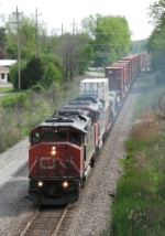 Q149 rolls west behind a pair of cowls