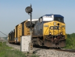 CSX 148 leads Q326-29 past the eastbound signal