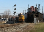 Q335 rolls past the old grain elevator and west end signal