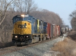 CSX 8772 & 4589 lead Q335 westward over one of the Plymouth Sub's small bridges