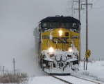 CSX 404 & 5438 head east in a cloud of snow as D801 with the Waverly pickup in tow