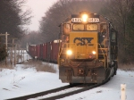 CSX 8435 leads Q327-24 across the Grand River in the last rays of light for the day