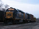 CSX 6458 & 2246 sit in the siding with W020-25
