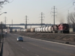 Traffic on Dearborn Ave pace 137 as it enters Rougemere Yard with a train from Canada
