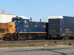 CSX 1300 poking out from behind a matching boxcar