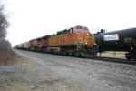 BNSF 4372 heads a unit grain train upgrade