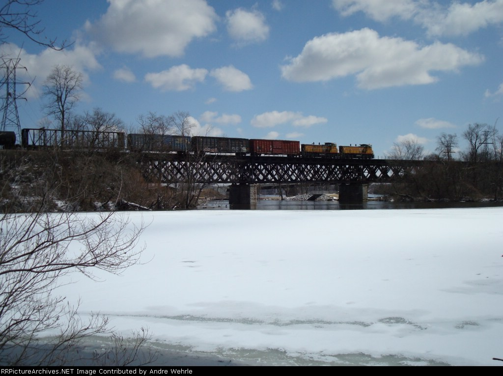 Wide view of the UP MP15s and train on the bridge
