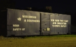WSOR Safety First boxcar by the roundhouse