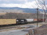 NS 6116 takes the NB  V86 Local out of the yard