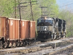 Three Thoroughbreds prepare to lashup with a string of Ballast cars