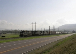 Mixed freight passing Merck's Stonewall facility