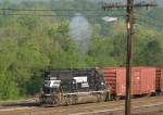 NS 7115 and a plume of smoke