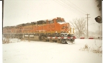 A very snow covered BNSF 5793 rolls south to KC, Ks., with a loaded coal train