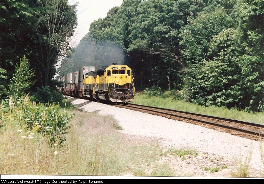 SD45 # 3634 and an SD70 crest the grade eastbound with a Sea-Land train