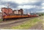 Inspection train WSPX rolls west through Port Jervis under threatening skies