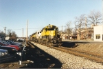 GP18 1802 leads an assortment of power east through town on a Hanjin train
