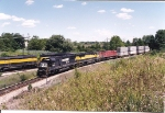 Westbound SU-99 holds on the Limecrest industrial as the SQ550 rolls east