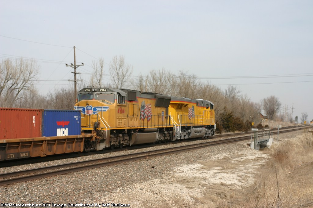 UP 4964  on the rear of the train.