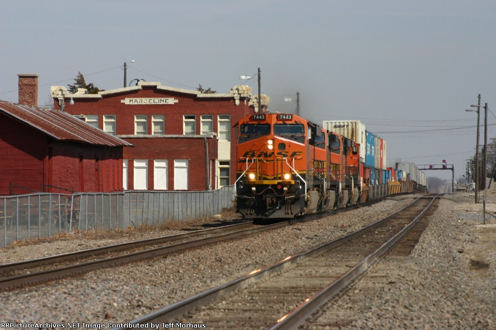 BNSF 7443 runs through town with a short KC bound train as it passes the old historic Santa Fe Depot which now displeys as Walt Disney Museam that opens on April 1, 2009