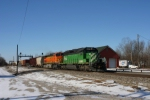 BNSF 7036  EB mixed freight passing the old Santa Fe Depot.