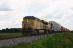 UP 7801 Heads west on this very humid 85 degree day.
