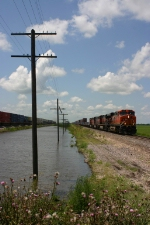 BNSF 7626 heads east as a westbound just passes by between Norborne and Carrollton at CR 623 crossing.