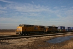 UP 7867 fly's past the melting ice on this nice 58 degree day at rout CC. MP 360.56